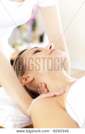 Radiant Young Woman Getting A Massage