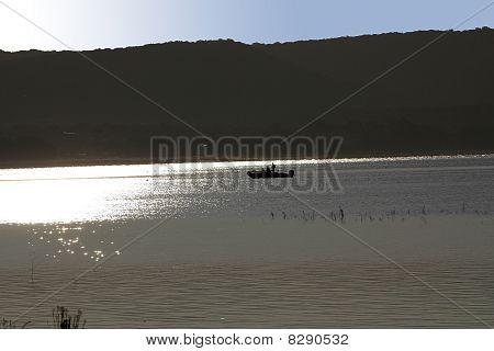 Silhouetted Fishermen