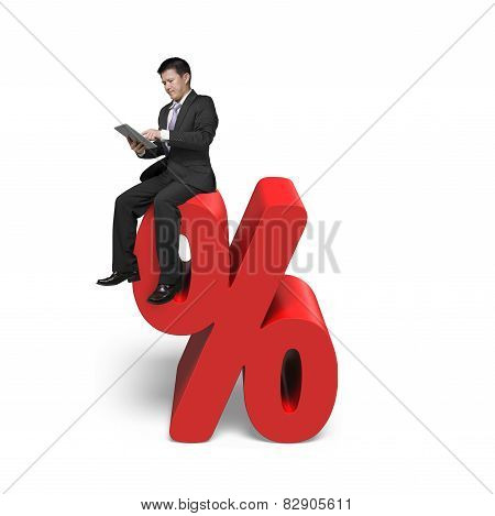 Using Tablet Businessman Sitting On Red Percentage Sign