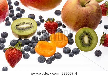 Halved Apricot And Kiwi Amidst Other Fruit