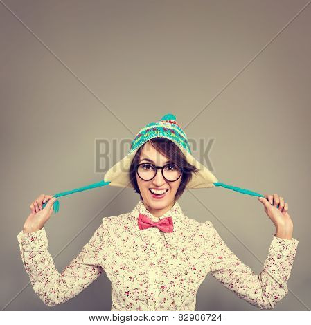 Portrait of Funny Hipster Girl in Winter Hat