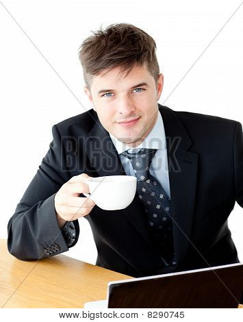 Charming Young Businessman Holding A Cup Smiling At The Camera