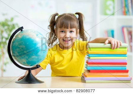 Portrait of kid girl considers Globe
