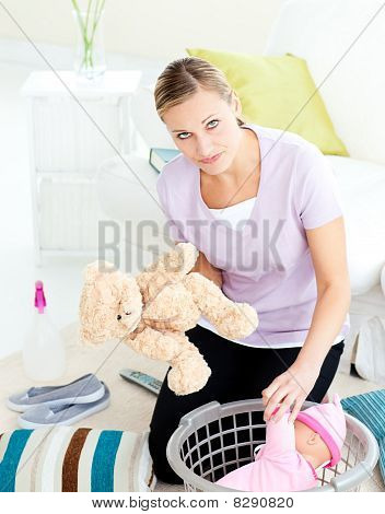 Depressed Young Mother Putting Toy Into A Basket