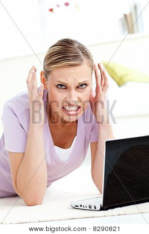 Aggressive Young Woman Using Her Laptop