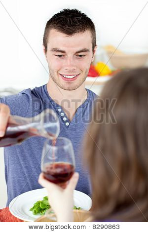 Attractive Man Having Dinner With His Girlfriend Drinking Wine