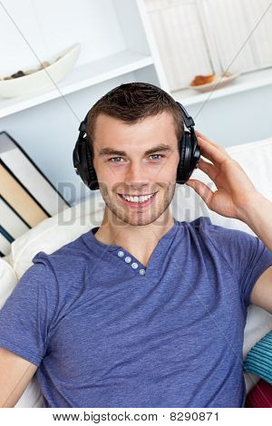 Smiling Caucasian Man Listen To Music With Headphones