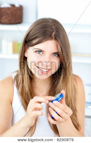 Merry Young Woman Using Cream For Her Lips