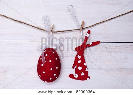 One Red Easter Bunny And Easter Egg Hanging On Line