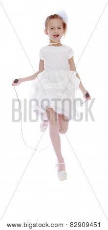 beautiful girl schoolgirl jumping on skipping rope.