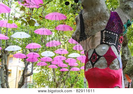 Knitted Clothes On Trees And Umbrellas Decorate Street In The Resort Town Bellaria Igea Marina, Rimi
