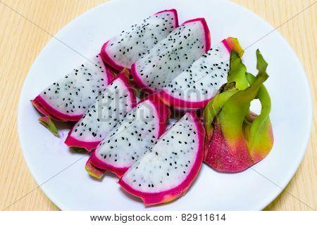 Dragon Fruit (pitaya) On Dish With Wood Background