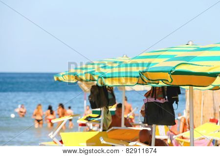 Sunbeds And Umbrellas On The Beach In The Resort Town Bellaria Igea Marina, Rimini, Italy