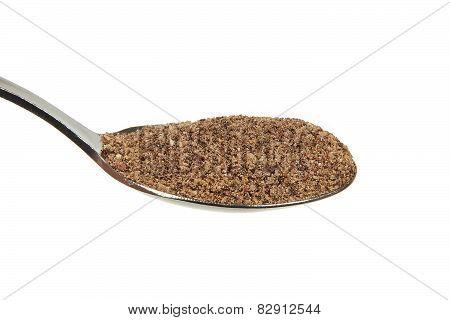Grinded black pepper on a teaspoon