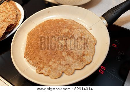 Pan With Flaxseed Meal Pancake On A Stove