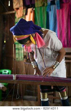 A Kayan Lahwi Oldest Woman Is Spinning.