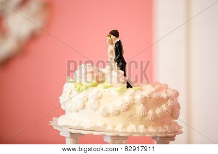 Photo Of Bride And Groom Figures On Top Of Wedding Cake
