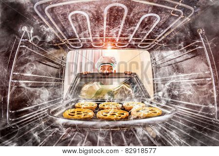Funny chef overlooked pastries in the oven, so she had scorched, view from the inside of the oven. Cook perplexed and angry. Loser is destiny!