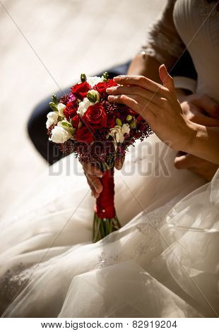 Toned Photo Of Bride Touching Roses In Bridal Bouquet