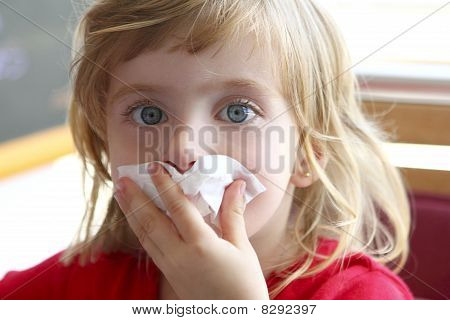 little blond girl tissue in nose