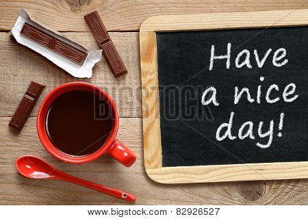 Coffee Cup And Chalkboard With Phrase Have A Nice Day!