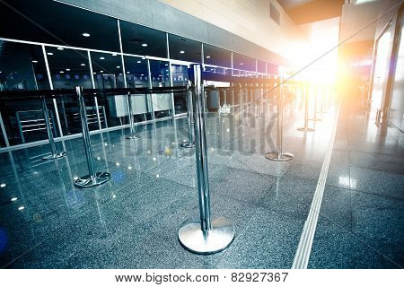 Empty Airport Check-in Line Lit By Sun Beam