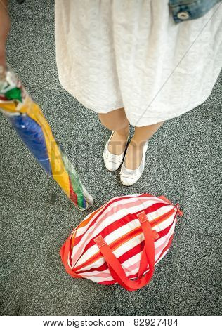 Photo Of Female Feet, Sun Umbrella And Beach Bag