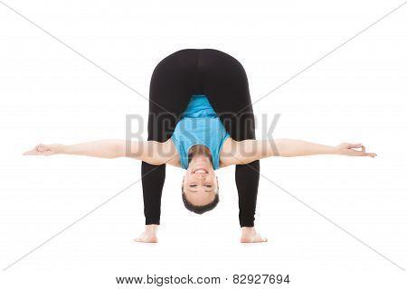 Yogi Female In Yoga Asana Bends Forward