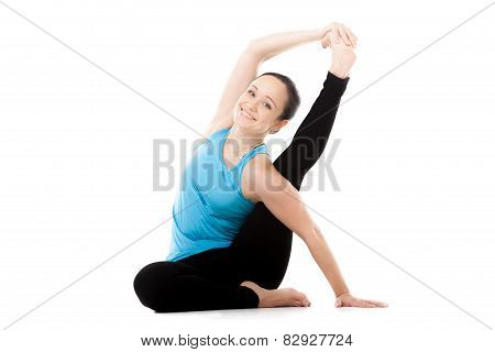 Yogi Female In Yoga Asana Parivritta Kraunchasana, Heron Pose