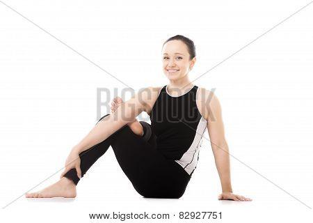 Yogi Female In Yoga Asana Parivritta Eka Pada Agni Stambhasana