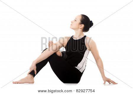 Yogi Athlete Girl In Yoga Asana Parivritta Eka Pada Agnistambhasana
