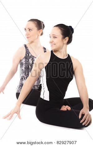 Two Smiling Yogi Girls Relaxing In Yoga Lotus Pose