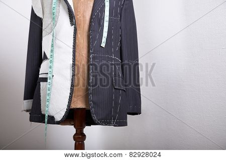 Semi-ready, elegant tailor made suit on dress stand