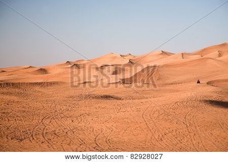 Desert dunes, an off-road vehicle alone