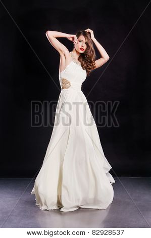 Beautiful attractive supermodel wearing gorgeous white dress