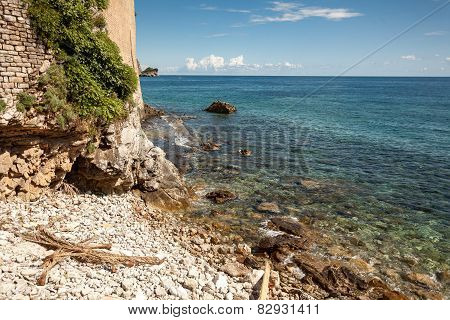 Landscape Of High Cliff On Sea Beach At Sunny Day