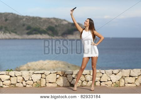 Sexy Woman Photographing A Selfie With A Smart Phone