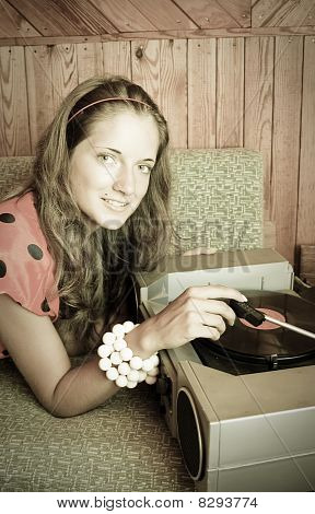 Lady With  Vinyl Plate And Record Player
