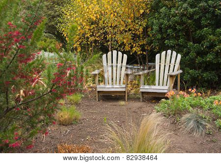 Two Adirondack chairs