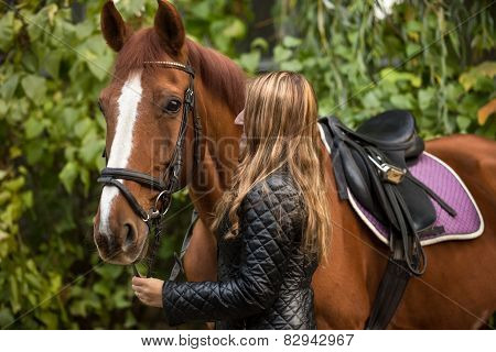Photo Of Beautiful Woman Holding Horse By Rein