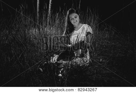 Monochrome Photo Of Beautiful Woman Reading Book At Night