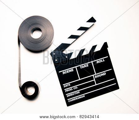 Two 35Mm Movie Reels And Clapperboard In Vintage Color Effect