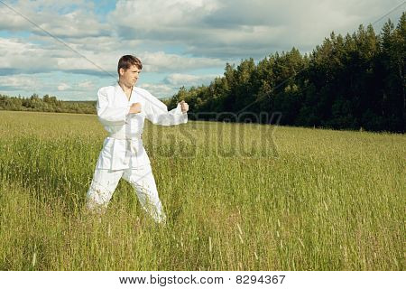 Man In Kimono Trains Karate In Open Air