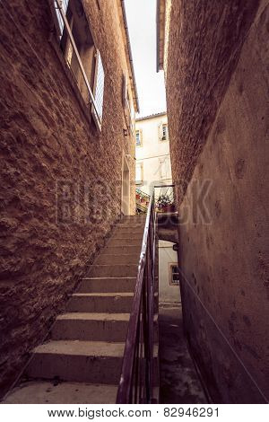 Toned Photo Of Big Stairway At Narrow Street