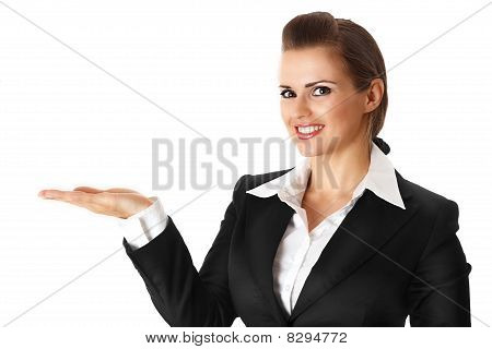 smiling modern business woman presenting something on empty hand
