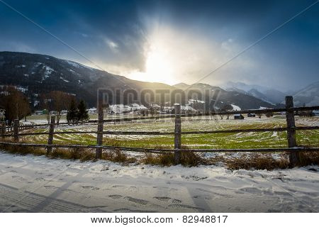 Landscape Of Highland Farm In Austrian Alps At Sunset