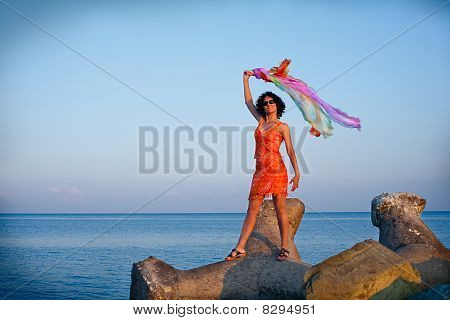 Happy Young Woman At The Sea