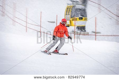Skier In Red Jacket Going Down The Hill Fast