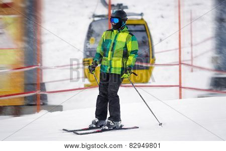 Male Skier Riding Down The Slope At Snowstorm