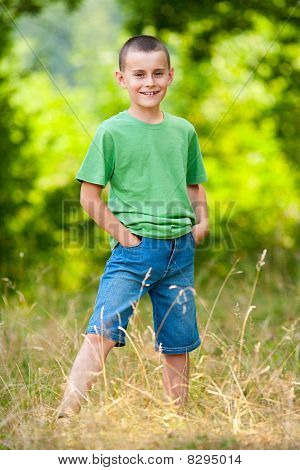 Young Boy In A Forest